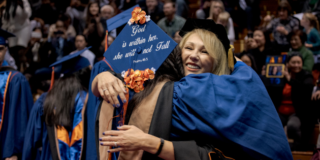 Bernice Ledbetter hugging student at commencement ceremony