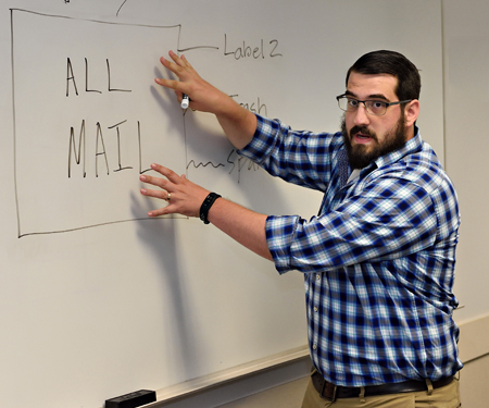 Man teaching in classroom