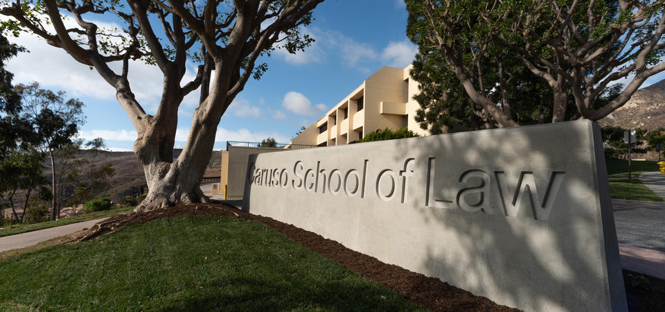 Caruso School of Law concrete sign on a sunny day in Malibu