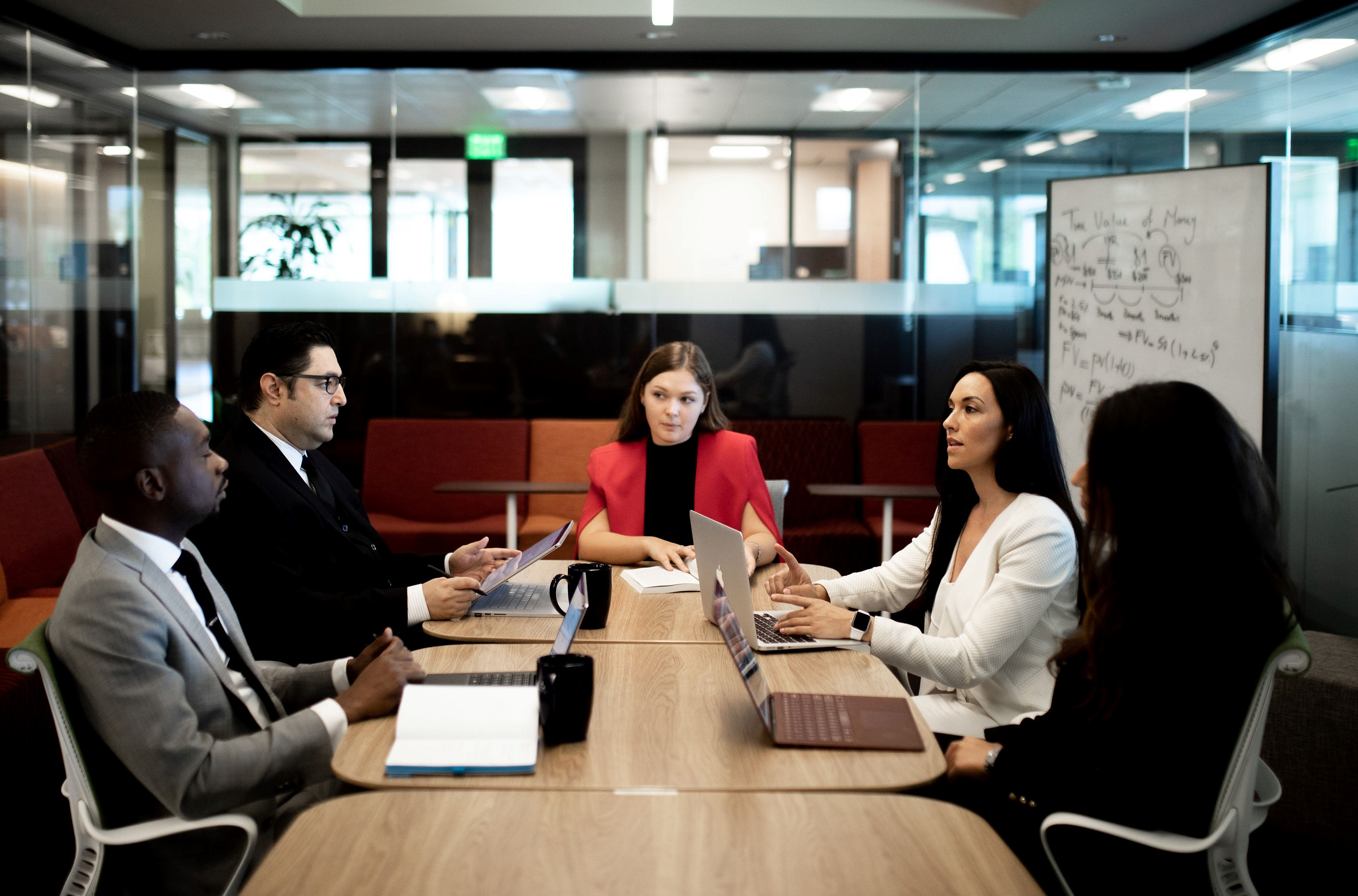 5 students in a meeting room