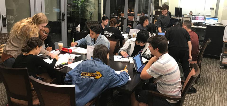 Group of students attending a tutoring session in the library
