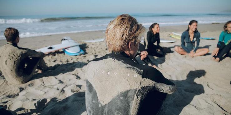 Seaver surf club students sitting on the beach