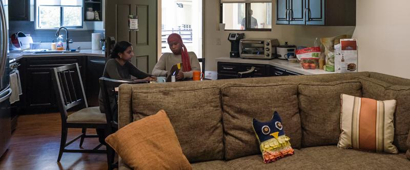 School of Law students studying at the breakfast area in their George Page Apartments kitchen.