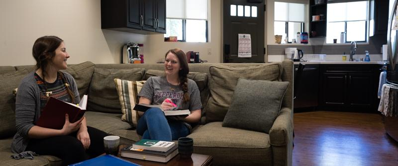School of Law students studying in the living room of their George Page Apartment.