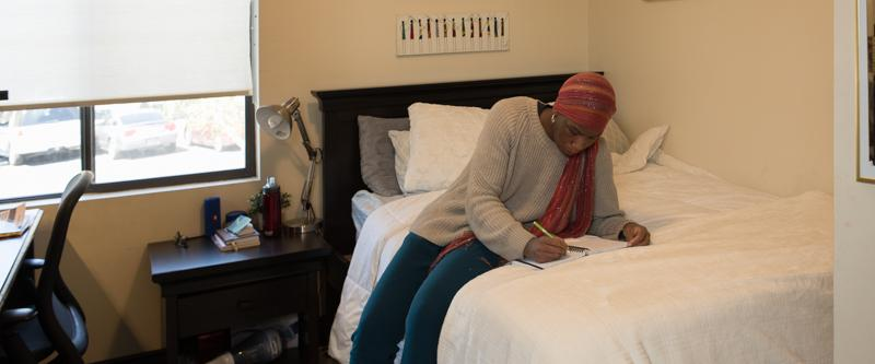 School of Law student studying in a George Page Apartments bedroom.