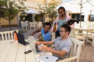 Students working on laptops outside of Drescher cafe