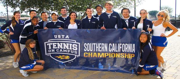 Members of the club tennis team holding their Southern California championship banner