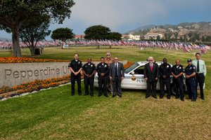 Pepperdine Public Safety team in front of Waves of Flags