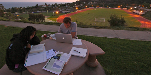 Seaver students studying on campus at sunset